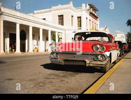 Red vintage car on the streets of Trinidad, Cuba. - Stock Photo