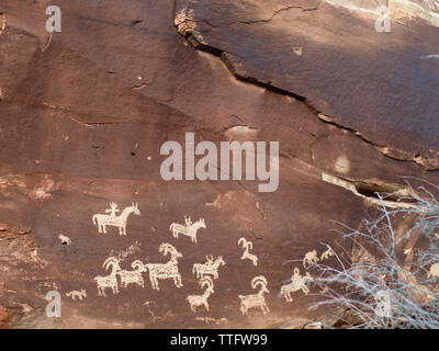 Petroglyphs on a rock wall, Arches National Park. - Stock Photo
