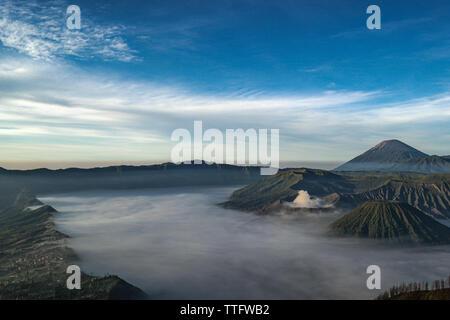 A view of Bromo Mountain and Semeru Mountain taken from Penanjakan Hill. - Stock Photo