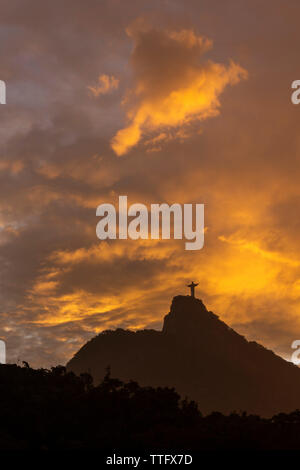 Beautiful sunset landscape with orange clouds over Christ the Redeemer - Stock Photo