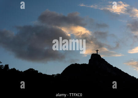 Beautiful landscape of Christ the Redeemer statue during sunset time - Stock Photo