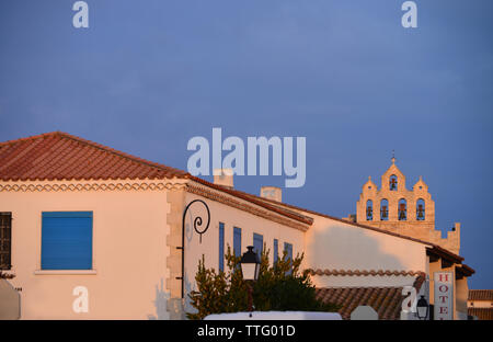 View of Saintes Maries de la Mer with Belltower of Church in background, Camargue, France - Stock Photo