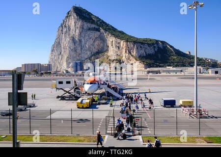 Gibraltar International Airport with passengers embarking on EasyJet plane - Stock Photo
