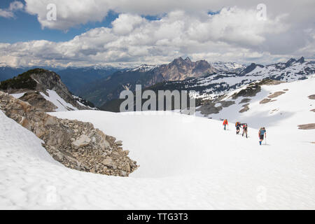 Mountaineers on approach to Cypress Peak, British Columbia. - Stock Photo