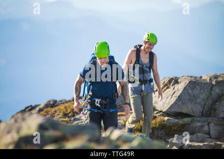 Two climbers enjoy the summit of Douglas Peak, British Columbia. - Stock Photo