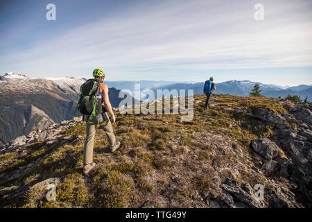 Rear view of climbers on the summit of Douglas Peak, B.C.