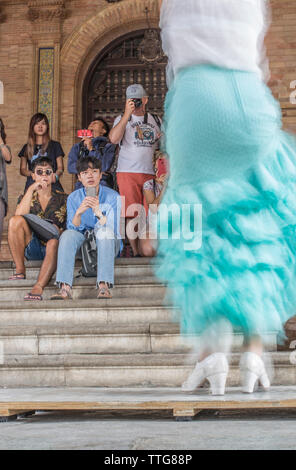 Flamenco dancer performing and Japanese tourists - Stock Photo