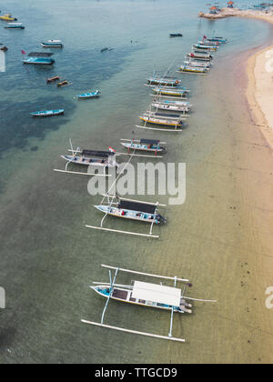 Aerial view of Balinese boats, Sanur beach, Bali, Indonesia - Stock Photo