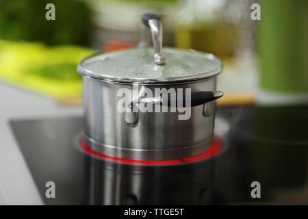 Pan on stove, closeup - Stock Photo