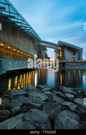 Norway architecture, view at dusk of the Astrup Fearnley Museet building designed by Renzo Piano sited on Tjuvholmen island in Oslo harbor, Norway. - Stock Photo