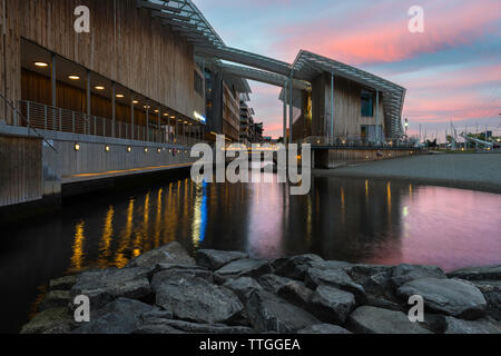 Oslo architecture, view at dusk of the Astrup Fearnley Museet building designed by Renzo Piano sited on Tjuvholmen island in Oslo harbor, Norway. - Stock Photo