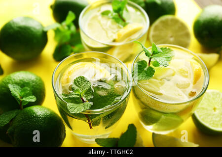Mojito drinks with lime, lemon and mint, closeup - Stock Photo