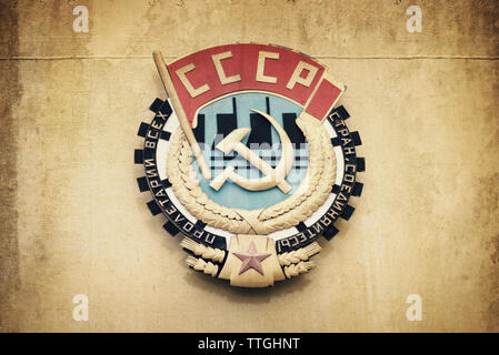 Soviet union CCCP emblem with hammer and sickle on a wall - Stock Photo