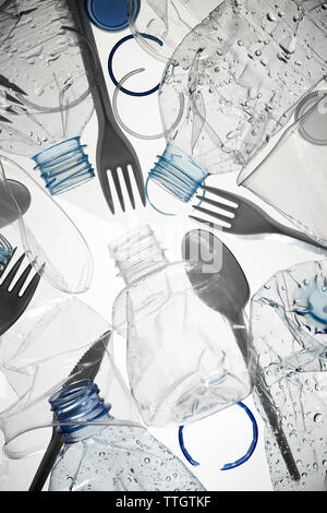 Used water bottles and plastic cutlery - Stock Photo