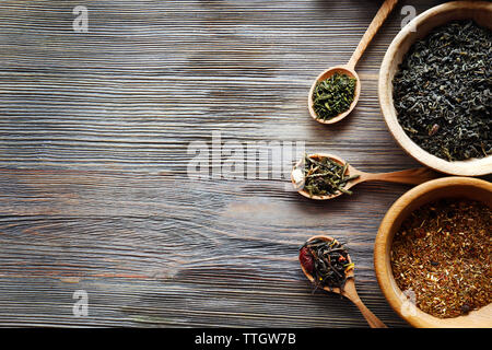 Tea concept. Different kinds of tea on wooden background - Stock Photo