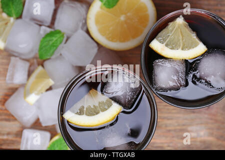 Two glasses of cola with cubes of ice and lemon, closeup - Stock Photo