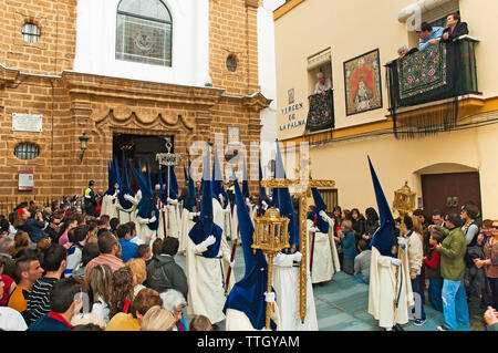 Holy Week. Brotherhood of La Palma. Nazarenes and Cross of Guide (head of the procession). Cadiz. Region of Andalusia. Spain. Europe - Stock Photo