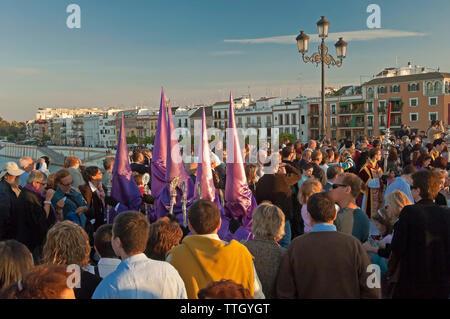 Holy Week. Brotherhood of La O (Nazarenes). Procession on the bridge of Triana. Seville. Region of Andalusia. Spain. Europe - Stock Photo