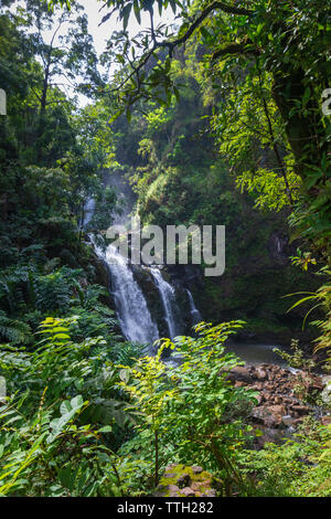 Upper Waikani Falls on the Hawaiian island of Maui at Mile 19 along the Road to Hana - Stock Photo