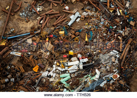 Metal scrap is scattered in a junk yard. - Stock Photo