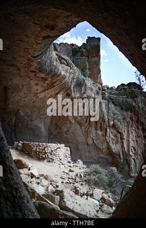 Midrange image of Alcove House and Kiva in Bandelier National Monument - Stock Photo