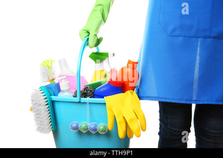 Woman holding cleaning tools and products in bucket, isolated on white - Stock Photo