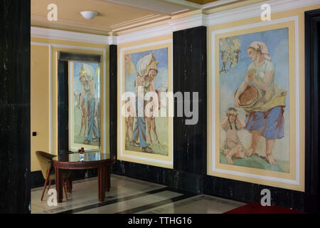 Venetian stucco panels by Czech artists Josef Novák and Stanislav Ullman on the main staircase of the in the Hotel International in Dejvice district in Prague, Czech Republic. The hotel inspired by Soviet Stalinist architecture was designed by Czech architect František Jeřábek and built in 1952-1956. - Stock Photo