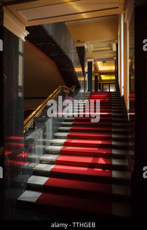 Main staircase in the Hotel International in Dejvice district in Prague, Czech Republic. The hotel inspired by Soviet Stalinist architecture was designed by Czech architect František Jeřábek and built in 1952-1956. The staircase railing was designed and manufactured by Czech artist Jan Nušl. - Stock Photo