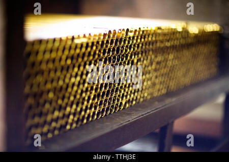 Stack of metallic pipes on table in factory - Stock Photo