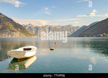 View of Kotor Bay with iconic Mount Lovcen and Perast village in the distance, Montenegro, Europe. - Stock Photo