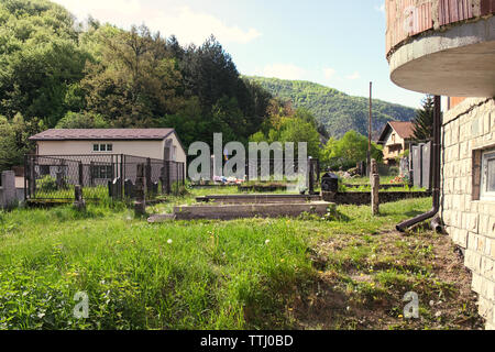 Old church with a cemetery in the backyard in the mountain village Martin Brod, Bosnia and Herzegovina