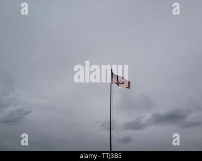 Low angle view of American flag against sky - Stock Photo