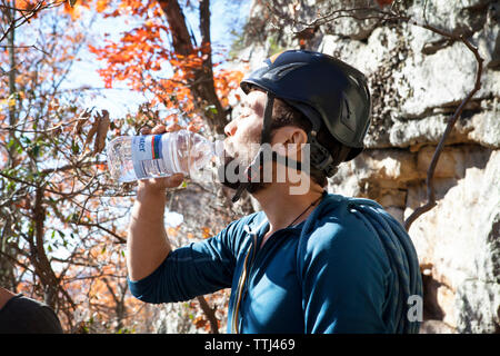 Side view of man drinking water - Stock Photo