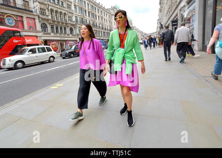 London, England, UK. Two colourfully-dressed Asian women in Regent Street - Stock Photo