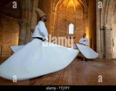 Nicosia, Cyprus, June 5 2019: Group of Dervishes performing the traditional and religious whirling dance or Sufi whirling - Stock Photo