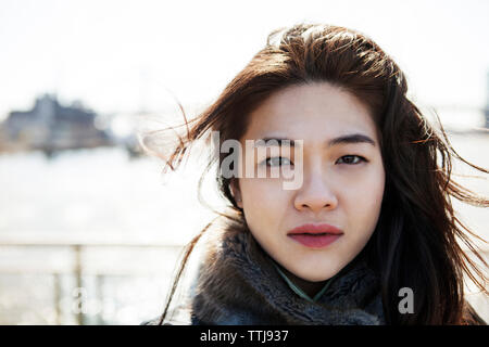 Close-up of woman standing against clear sky - Stock Photo