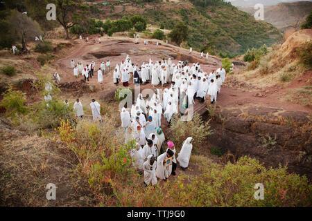 High angle view of pilgrim walking on mountain - Stock Photo
