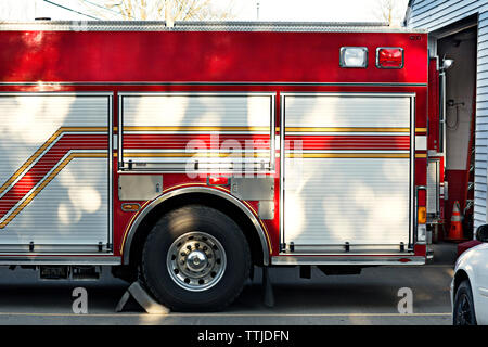 Cropped image of fire engine outside fire station - Stock Photo