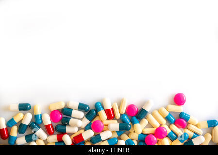 Colorful pills and medication on white background with copy space, health and medication concept - Stock Photo