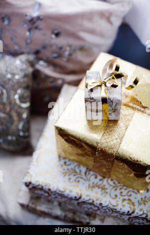 High angle view of gift boxes on alcove window seat - Stock Photo