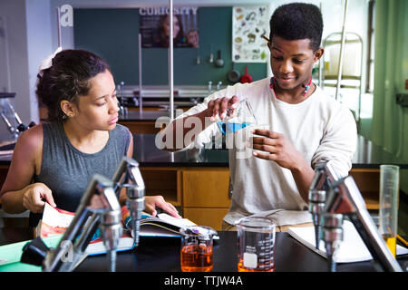 Students experimenting in laboratory - Stock Photo