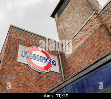 London / UK - June 15th 2019 - Underground sign outside Wood Green station on the piccadilly line, in the borough of Haringey - Stock Photo