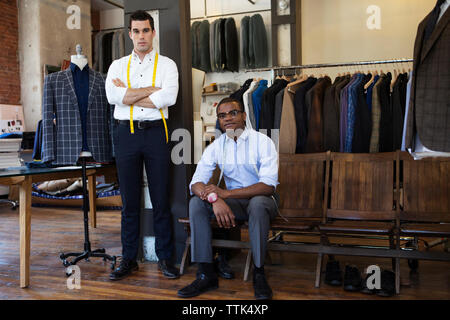 Confident design professionals at workshop - Stock Photo