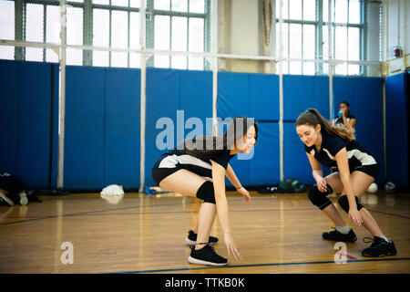 Teenage girls playing on wooden floor at court - Stock Photo