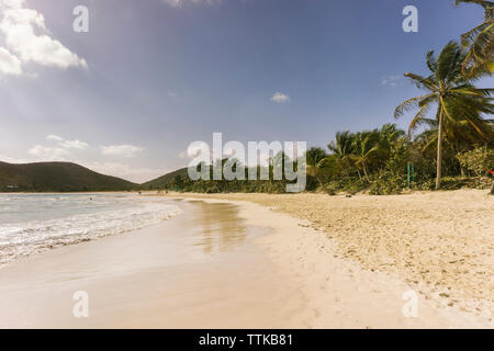 Scenic view beach against sky - Stock Photo