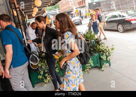 Diners arrive at the new Pastis restaurant in the Meatpacking District in New York on Friday, June 7, 2019 on its opening. Opened in 1999 and closed in 2014 the original has taken on a legendary status, attracting celebrity and regular patrons. (© Richard B. Levine) - Stock Photo