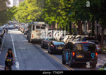 Traffic backed up on Central Park North in the neighborhood of Harlem in New York on Tuesday, June 11, 2019. (© Richard B. Levine) - Stock Photo