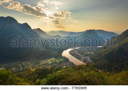 Sunset over the town of Nong Khiaw and Nam Ou River from the Pha Daeng Peak Viewpoint, Nong Khiaw, Muang Ngoi District, Luang Prabang Province, Northe - Stock Photo