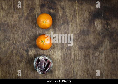 Overhead view of fresh oranges on wooden table - Stock Photo
