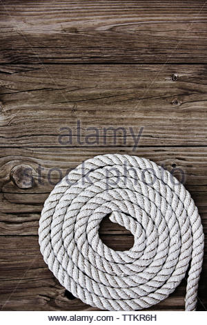 High angle view of rope on wooden table - Stock Photo